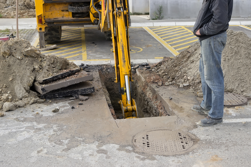Excavating sewer line